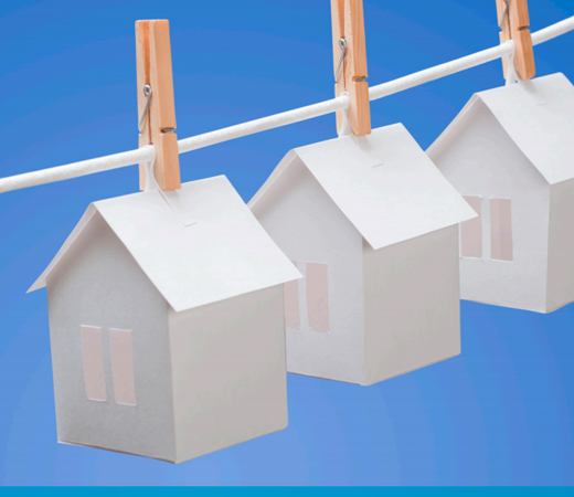 Paper houses on washing line